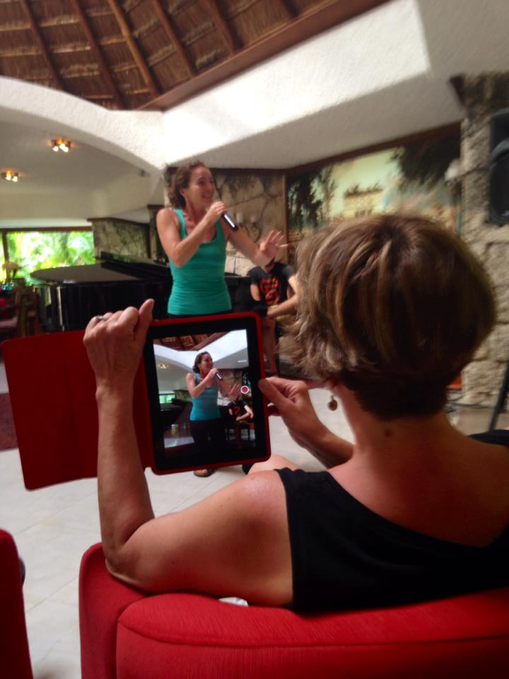 Paula being filmed while singing for our guests.