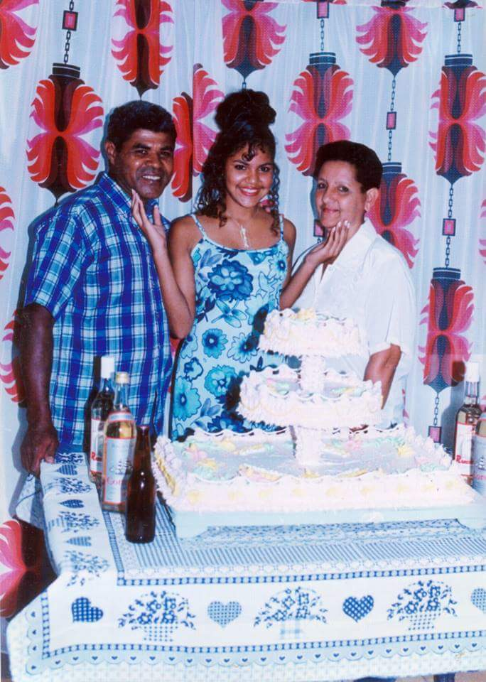 Mayret's Cumple 15 with her parents.